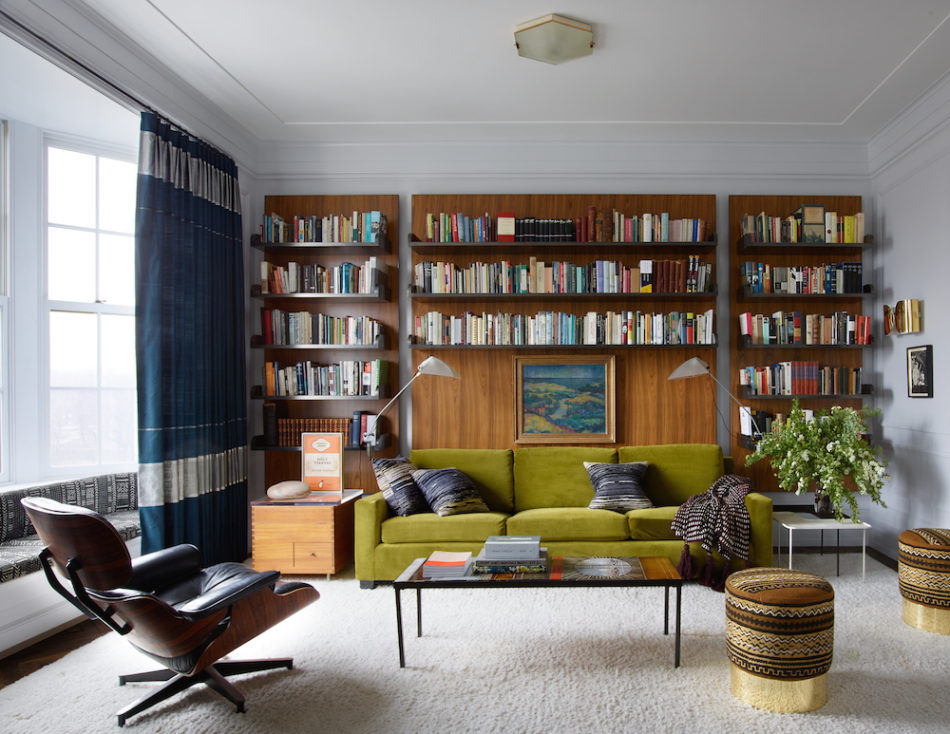living room with green couch and stools