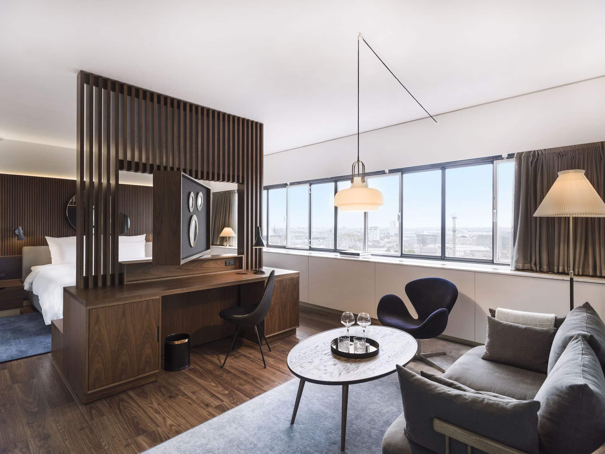 A modernist guest room at the Radisson Blu Royal Hotel in Copenhagen designed by Arne Jacobsen