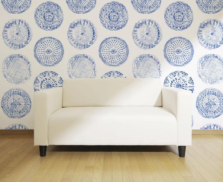 Brooklyn Manhole wallpaper in blue by Merenda Wallpaper