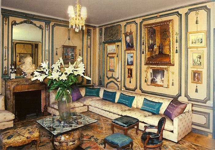 """De Wolfe's private sitting room at Villa Trianon. The pillows are embroidered with her aphorisms: """"Never explain, never complain"""" and """"I believe in optimism and plenty of white paint!"""""""