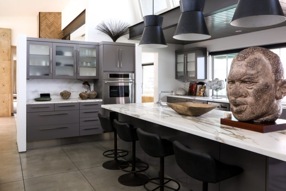A sculpture of Paul Robeson offsets the clean lines of this Laguna Beach, California, kitchen by Cliff Fong.