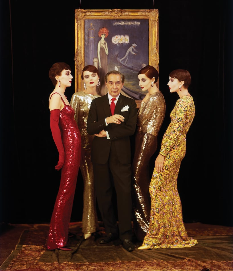 Norell with models wearing his hand-sewn sequined mermaid gowns, Fall 1960.