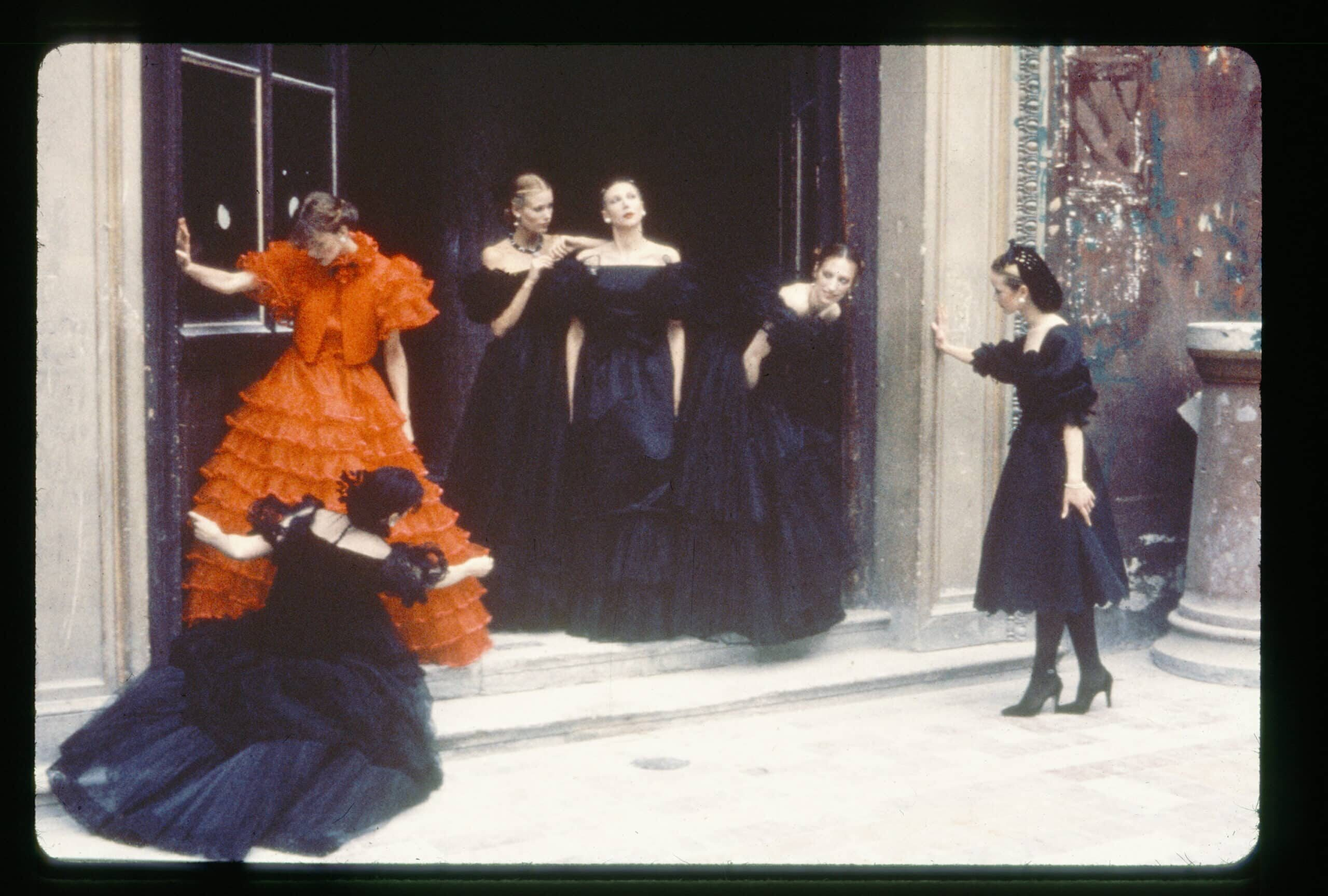 women in black and red dresses